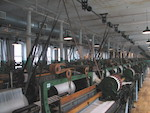 Inside the Boott mill with the clattering looms running themselves