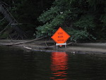 A freak accident sets a road sign on the Merrimack River